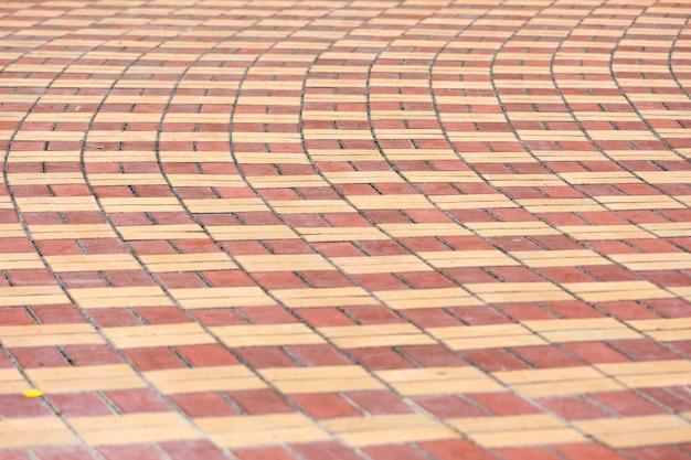 Pflastersteine, gemusterte pflasterungsfliesen, zementziegelsteinbodenhintergrund
