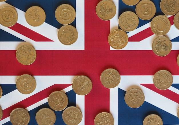 Pfund-münzen, vereinigtes königreich über flagge