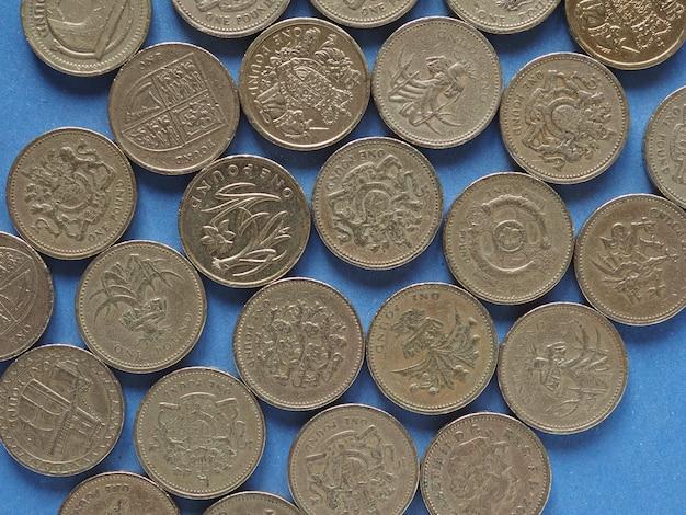 Pfundmünzen, vereinigtes königreich über blau