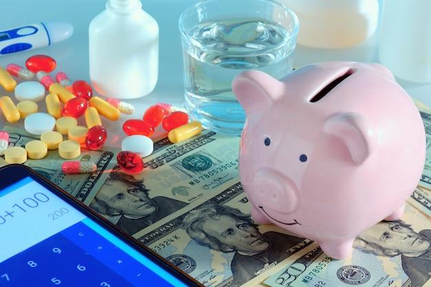 Piggibank, rechner und pillen