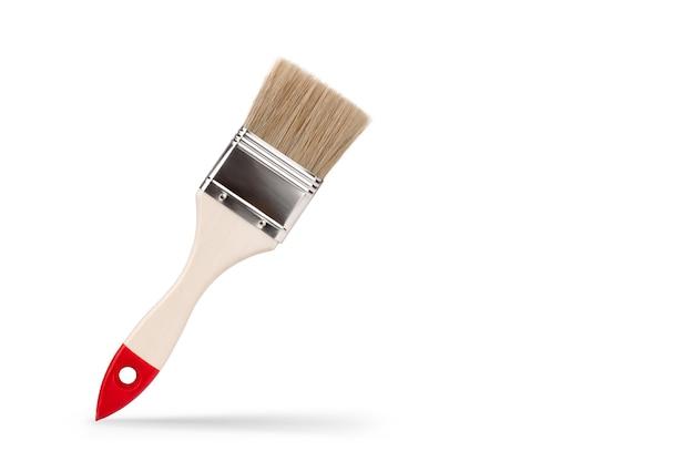Pinsel mit groben borsten arbeitswerkzeug auf weißem hintergrund isolieren