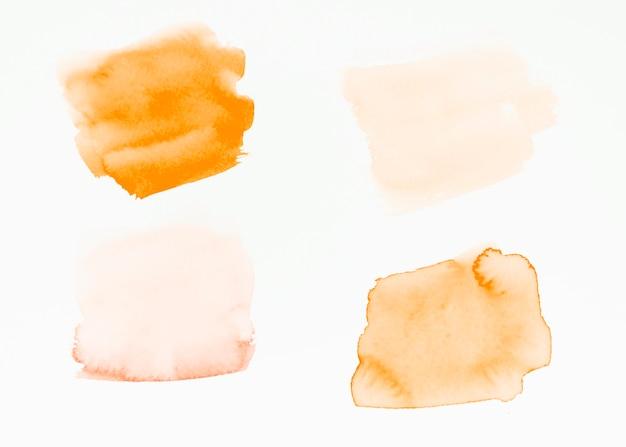 Pinselanschläge einer orange getrennt auf weißem hintergrund