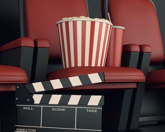 Plättchenbrett und popcorn des kinos 3d auf theatersitz.