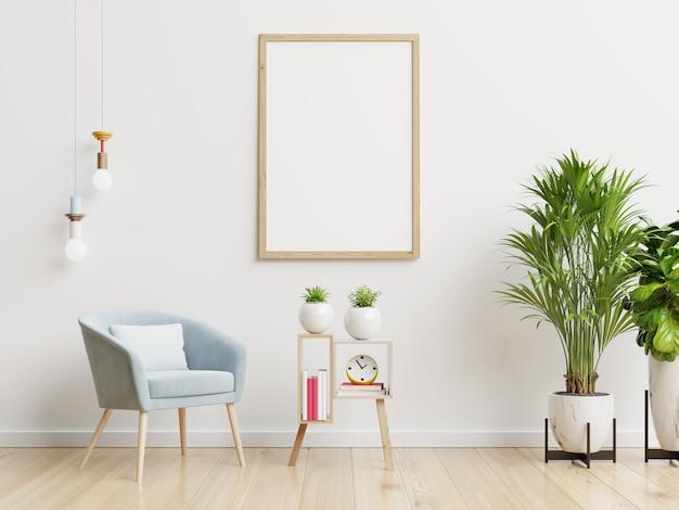 Plakatmodell mit vertikalen rahmen auf leerer weißer wand im wohnzimmerinnenraum mit blauem samtsessel. 3d-darstellung