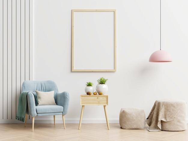 Plakatmodell mit vertikalen rahmen auf leerer weißer wand im wohnzimmerinnenraum mit blauem samtsessel. 3d-rendering