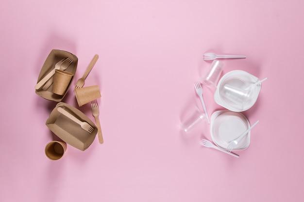 Plastik- und papierutensilien auf rosa auswahl umweltfreundlicher utensilien