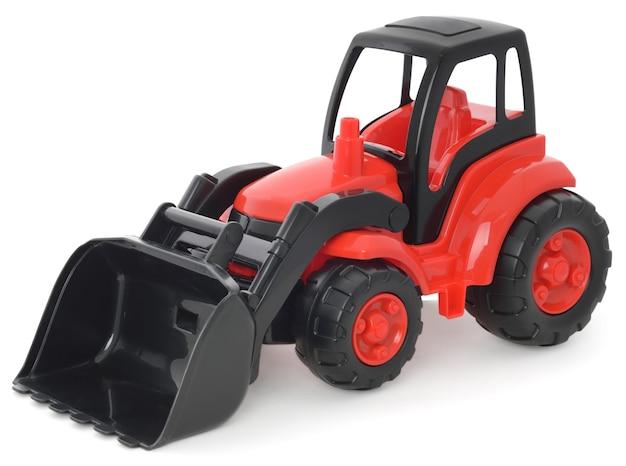 Plastikspielzeug der kinder, rot-schwarzer bulldozer lokalisiert auf weiß