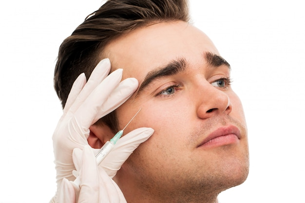 Plastische chirurgie. attraktiver, gutaussehender mann
