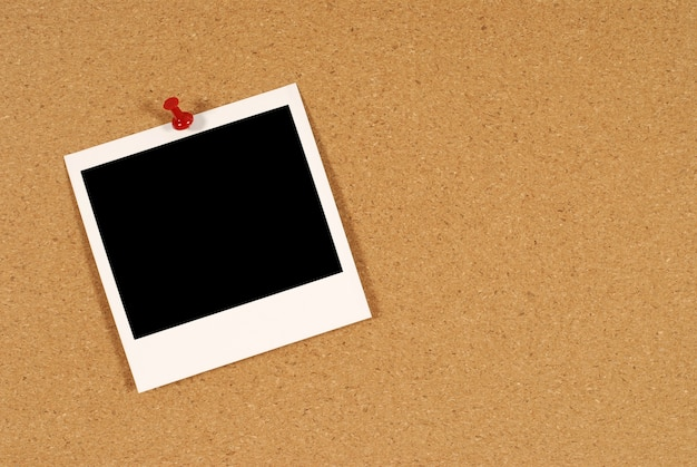 Polaroid-foto auf kork bord