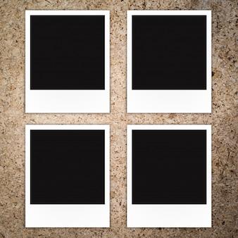 Polaroidfotorahmen auf hölzernem hintergrund