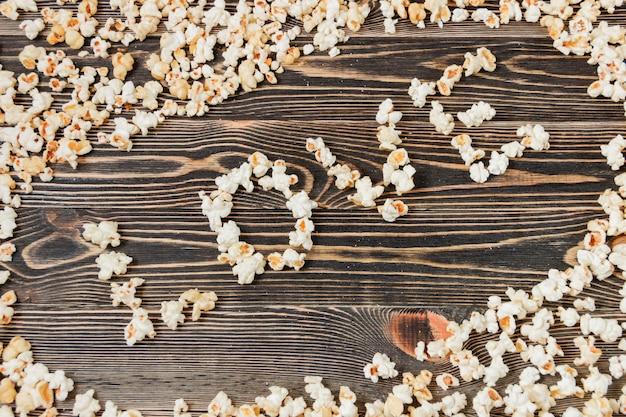 Popcorn-liebes-beschaffenheits-hintergrund-ungesundes lebensmittel