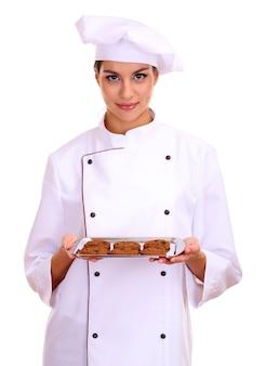 Porträt der jungen köchin mit tablett lokalisiert auf weiß