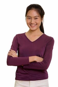 Porträt des jungen glücklichen asiatischen teenager-mädchens lächelnd