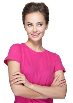 Porträt einer lächelnden jungen frau, die weg schaut - lokalisiert