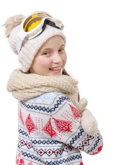 Porträt eines glücklichen jungen mädchens snowboarden