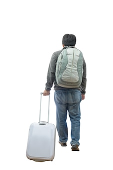 Porträt eines mannes, der mit koffer und tasche reist