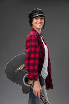 Porträt weiblicher gitarrist Kostenlose Fotos