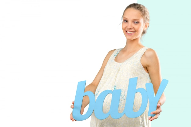 Portrait der jungen glücklichen lächelnden schwangeren frau