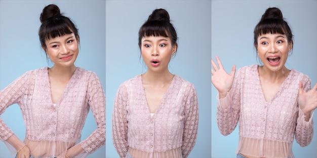 Portrait of fashion 20s asian woman hat ein schönes update-make-up-farblippenstift, sie trägt pastellrosa modische artikel, starkes gefühl posiert über graublauem hintergrund isolierter kopienraum