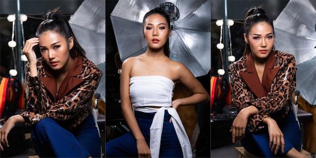 Portrait of fashion 20s asian woman hat eine schöne modische jacke, die stark in einem dekorierten studio posiert, um ein magazin mit blitz und ausrüstung zu schießen