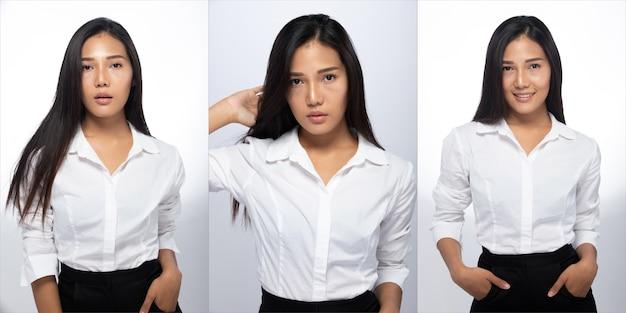 Portrait of fashion 20s asian woman hat schöne schwarze lange glatte haare, sie trägt weißes hemd blick in die kamera auf weißem hintergrund isoliert