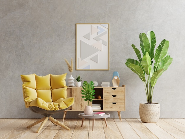Postermodell mit vertikalem rahmen auf leerer dunkler betonwand im wohnzimmer mit gelbem sessel. 3d-rendering