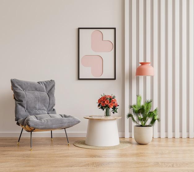 Postermodell mit vertikalen rahmen an leerer weißer wand im wohnzimmer mit blauem samtsessel. 3d-rendering