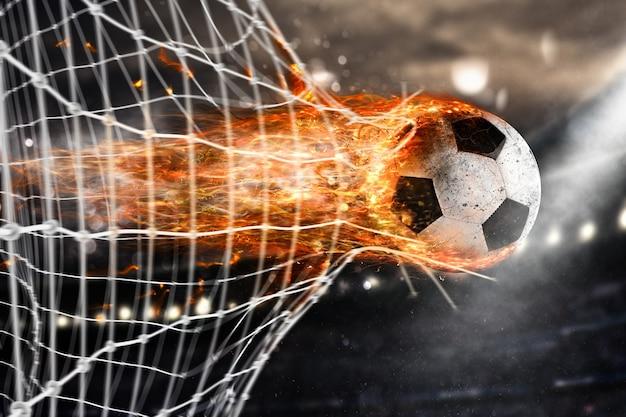 Professioneller fußball-feuerball hinterlässt flammenspuren und erzielt ein tor im netz