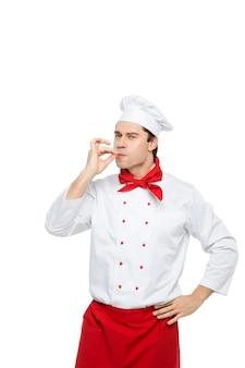 Professioneller kochmann auf einem weiß.