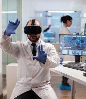 Professioneller wissenschaftler mit medizinischer innovation im labor using