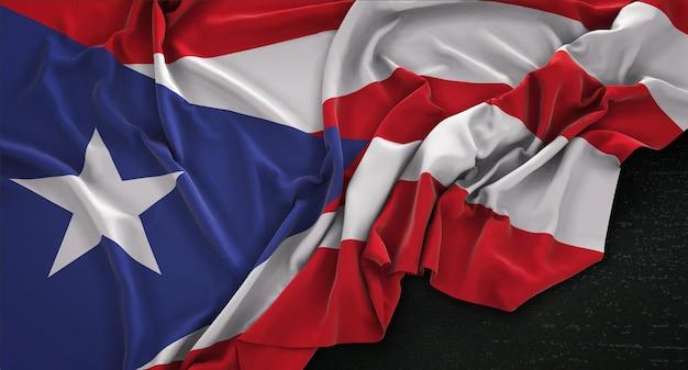 Puerto rico fahne geknickt auf dunklem hintergrund 3d render