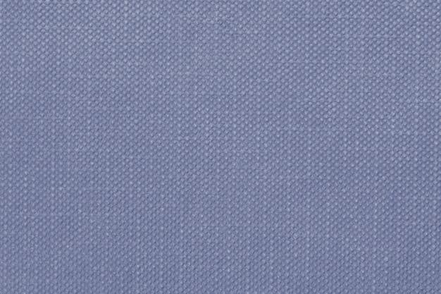 Purpurblauer strukturierter textilhintergrund mit prägung