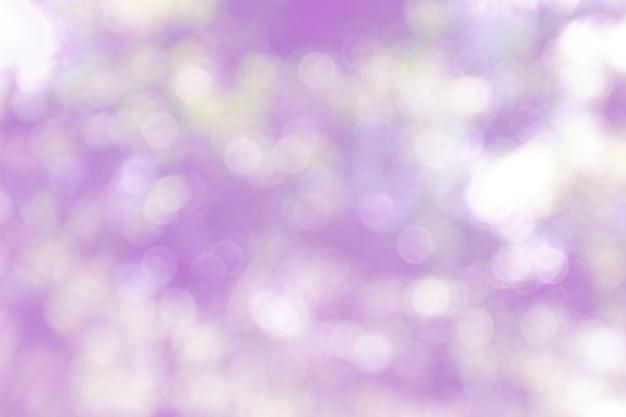 Purpurroter bokeh zusammenfassungshintergrund, unscharf