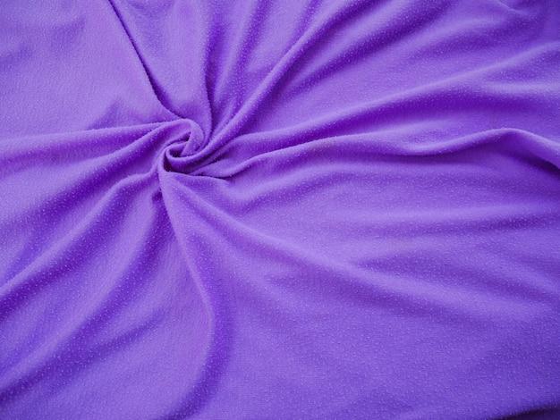 Purpurroter seidengewebebeschaffenheitshintergrund, sportkleidung