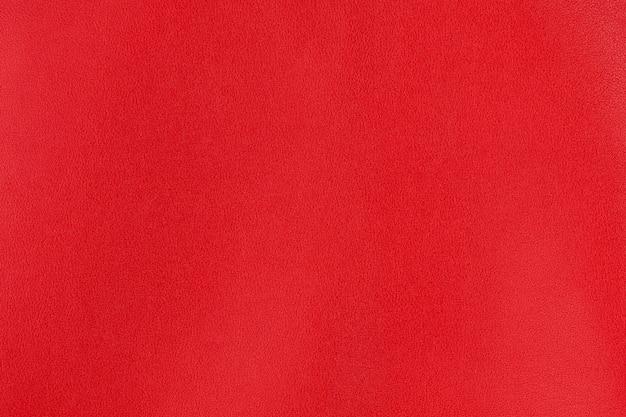 Purpurroter strukturierter glattlederoberflächenhintergrund, kleine körnung