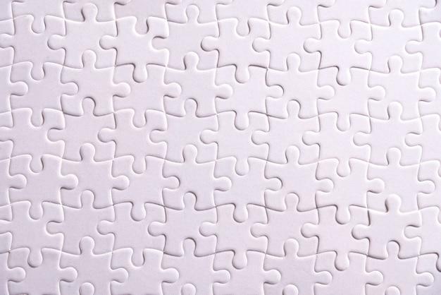 Puzzle, weißes puzzle besteht aus vielen teilen.