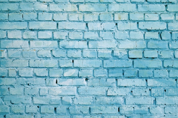 Quadratischer backsteinblockmauerhintergrund und -beschaffenheit. in blau lackiert
