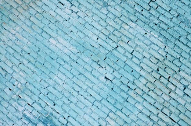 Quadratischer backsteinblockwandhintergrund und -beschaffenheit. in blau lackiert
