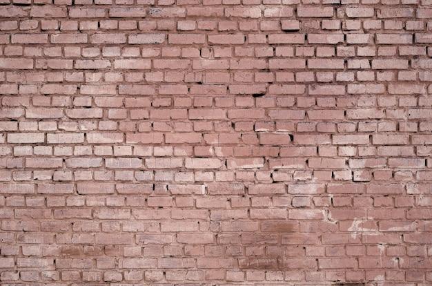 Quadratischer backsteinblockwandhintergrund und -beschaffenheit. in rot gemalt