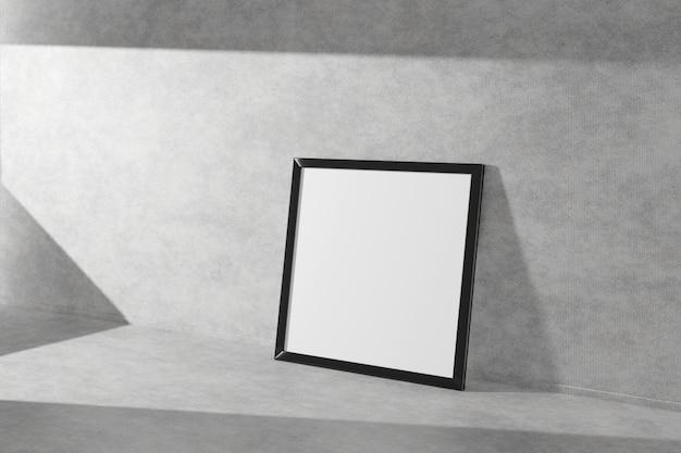 Quadratischer bilderrahmen in schwarzer farbe auf einem betonboden. 3d-rendering