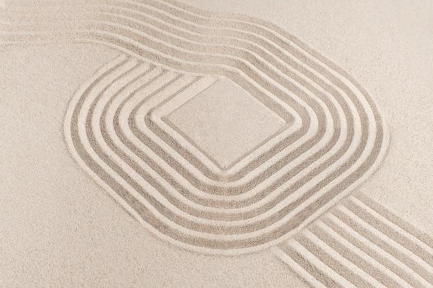 Quadratischer zen-sandhintergrund im achtsamkeitskonzept