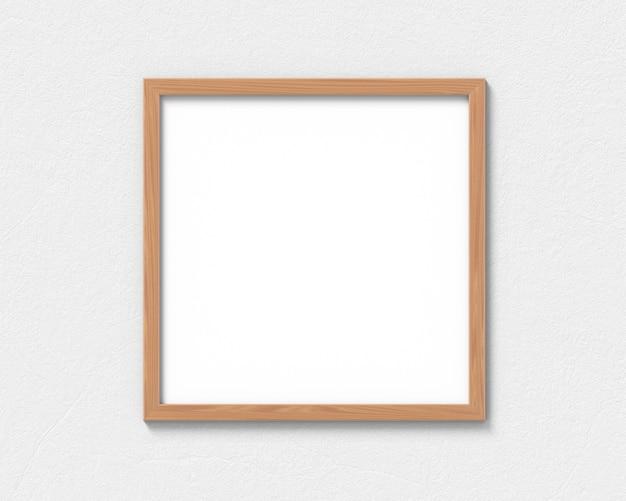 Quadratisches holzrahmenmodell, das an der wand hängt. leere basis für bild oder text. 3d-rendering.