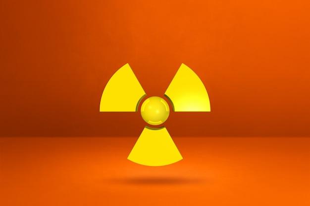 Radioaktives symbol isoliert auf einem orangefarbenen studio