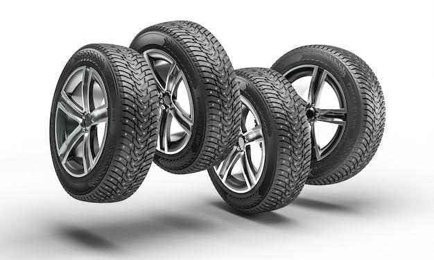 Räder mit winterreifen, die auf weißem hintergrund springen. 3d-rendering
