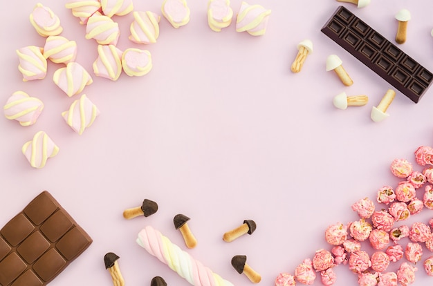 Rahmen am set aus verschiedenen süßigkeiten