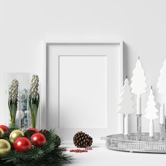 Rahmen-modell auf weißer wand mit weihnachtsdekoration