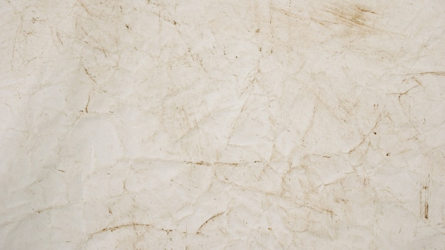 Raue beige papierschmutz-hintergrundbeschaffenheit für design