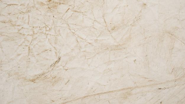 Raue beige papierschmutz-hintergrundbeschaffenheit
