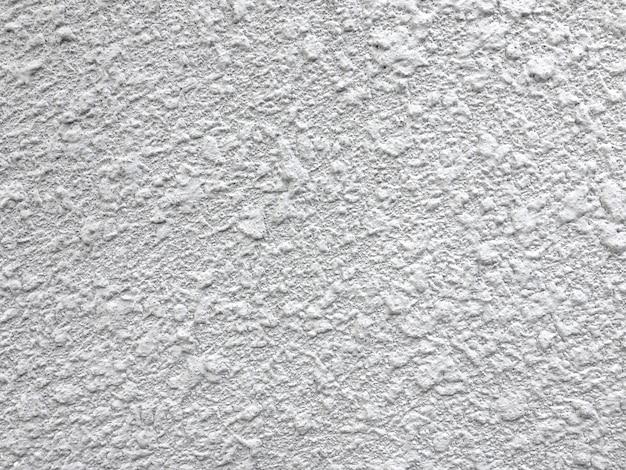 Raue beschaffenheit des grauen konkreten hintergrundes. detail der grunge kleberoberfläche.