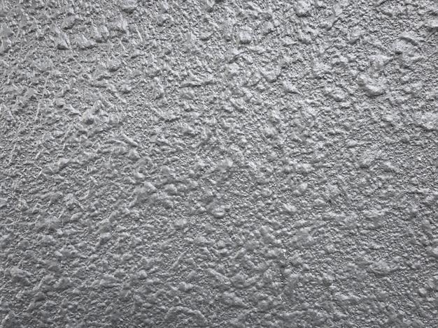 Raue beschaffenheit des grauen konkreten hintergrundes.